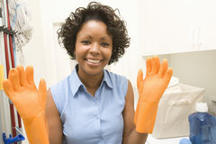 Woman Wearing Rubber Gloves Royalty Free Stock Photos