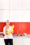 Woman wearing rubber gloves Royalty Free Stock Images
