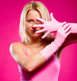 Woman wearing rubber gloves posing indoors Stock Images