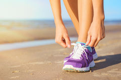 Woman wearing running shoes Royalty Free Stock Photos