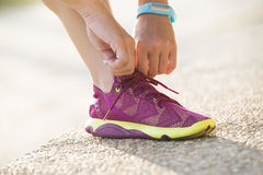 Woman wearing running shoes Stock Images