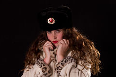 Woman wearing russian fur hat Stock Images