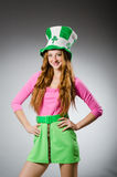 Woman. Wearing saint patrick hat stock photography