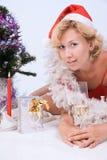 Woman wearing santa claus Stock Photo