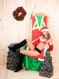 Woman wearing santa claus clothes Royalty Free Stock Image
