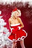 Woman wearing santa claus clothes Royalty Free Stock Photography