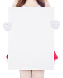 Woman wearing santa claus clothes with blank sign royalty free stock images