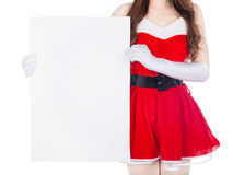 Woman wearing santa claus clothes with blank sign on white backg Royalty Free Stock Photography