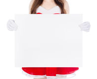 Woman wearing santa claus clothes with blank sign on white backg Stock Photo