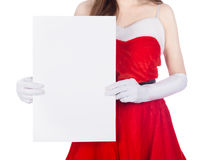Woman wearing santa claus clothes with blank sign on white backg Royalty Free Stock Images