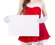Woman wearing santa claus clothes with blank sign on white backg Royalty Free Stock Image