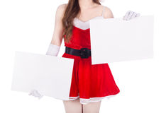 Woman wearing santa claus clothes with blank sign on white backg Royalty Free Stock Photos