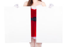 Woman wearing santa claus clothes with blank sign on white backg Stock Images