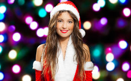 Woman wearing Santa Claus costume Stock Images