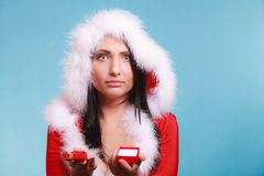 Woman wearing santa claus costume holds gift box on blue Royalty Free Stock Photography