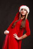 Woman wearing santa claus hat on black Royalty Free Stock Image