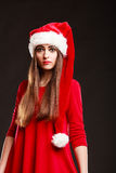 Woman wearing santa claus hat on black Royalty Free Stock Images