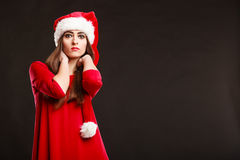 Woman wearing santa claus hat on black Royalty Free Stock Images