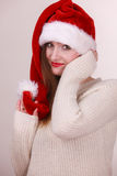 Woman wearing santa claus hat Stock Photos