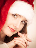 Woman wearing santa claus hat portrait. Royalty Free Stock Image
