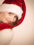 Woman wearing santa claus hat portrait. Christmas time. Young latin woman wearing santa claus hat portrait. Studio shot Stock Photo