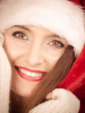 Woman wearing santa claus hat portrait. Stock Photo