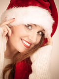 Woman wearing santa claus hat portrait. Royalty Free Stock Images