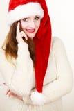 Woman wearing santa claus hat portrait. Christmas time. Young latin woman wearing santa claus hat white warm sweater portrait. Studio shot Stock Images