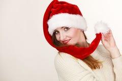 Woman wearing santa claus hat portrait. Christmas time. Young latin woman wearing santa claus hat white warm sweater portrait. Studio shot Royalty Free Stock Photo