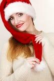 Woman wearing santa claus hat portrait. Christmas time. Young latin woman wearing santa claus hat white warm sweater portrait. Studio shot Stock Photography