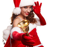 Woman wearing santa claus hat ringing a bell. Happiness holidays Royalty Free Stock Photos