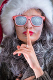Woman wearing Santa Claus hat and sunglasses Stock Image