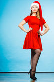 Woman wearing Santa Claus helper costume dress Stock Images