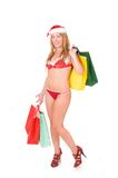 Woman wearing santa claus lingerie with presents Stock Photography