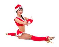 Woman wearing santa claus makes splits Stock Photography
