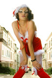 Woman wearing santa claus red clothes Stock Image