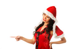 Woman wearing santa clothes, pointing left Royalty Free Stock Photos