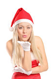 Woman wearing santa costume giving kisses Stock Image