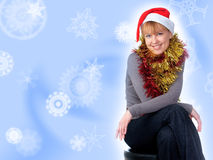 Woman wearing a santa hat Royalty Free Stock Images