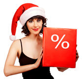 Woman wearing santa hat Stock Photos