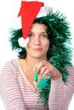 Woman wearing a santa hat Royalty Free Stock Photography