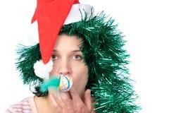 Woman wearing a santa hat Royalty Free Stock Photos