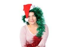 Woman wearing a santa hat Stock Photo