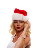 Woman wearing Santa Hat,. A attractive woman is wearing a Santa Claus cap royalty free stock images