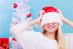Woman wearing Santa hat that covers her eyes Stock Photos