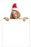 Woman wearing Santa hat holding blank sign Royalty Free Stock Photos