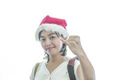 Woman wearing santa hat Stock Images