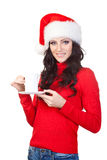 Woman wearing santa hat and red sweater Royalty Free Stock Photography