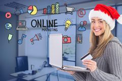 Woman wearing Santa hat while shopping online. Digital composite of Woman wearing Santa hat while shopping online Stock Photos