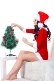 Woman wearing santa helper costume Stock Image